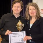 members of Moonlight Mandolin Orchestra with BMG cup