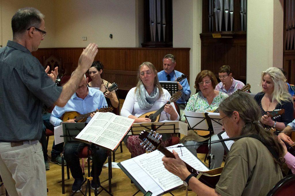 Hugh conducting the Moonlight Mandolin Orchestra