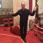 Hugh waving baton
